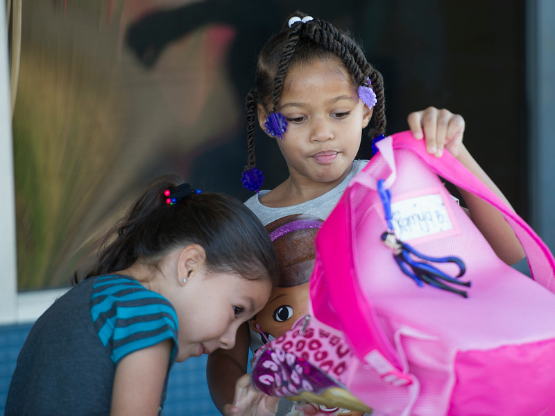 Kamya Berryman, 5, right, shows Isabel Escobar, 5, whats inside her backpack during the first day of school at Killian Elementary School in Rowland Heights on Monday August 18, 2014. About 650 students are attending Killian and this is the first day of school for the whole Rowland Unified School District. (Photo by Keith Durflinger/San Gabriel Valley Tribune)