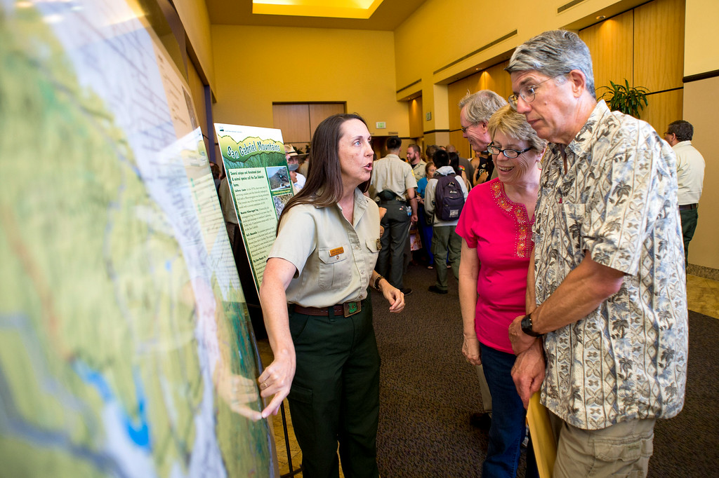 Description of . Wildlife biologist Ann Berkley, of the U. S. Forest Service, speaks with Colleen and Brian Bennett, of La Verne, during a San Gabriel Mountains meeting Tuesday night, August 26, 2014 at Baldwin Park Performing Arts Center. Rep. Judy Chu has a bill to make the area a national recreation area but has since asked President Obama to make the mountains a national monument.  Brian is with the La Verne Land Conservancy. (Photo by Sarah Reingewirtz/Pasadena Star-News)