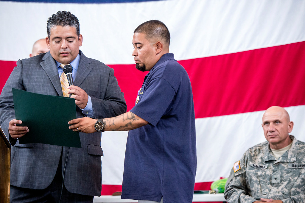 Description of . La Puente City Councilman David Argudo gives an award to Sgt. Luis Bardales, a resident of Irwindale who works for the city of South Pasadena, after he received a Purple Heart at the Army National Guard in Azusa Saturday, July 12, 2014. Bardales was wounded by a roadside IED in Baghdad, Iraq and saved gunner Gabriel Herrera by pulling him out of their Humvee before another IED explosion. (Photo by Sarah Reingewirtz/Pasadena Star-News)