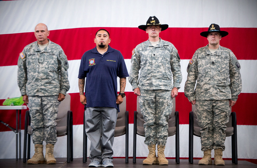 Description of . Sgt. Luis Bardales, a resident of Irwindale who works for the city of South Pasadena, receives a Purple Heart at the Army National Guard in Azusa Saturday, July 12, 2014 while being flanked by Brig. Gen. Mark Malanka, left, Lt. Col. Jesse Miller and Sgm. Andrew McKindley. Bardales was wounded by a roadside IED in Baghdad, Iraq and saved gunner Gabriel Herrera by pulling him out of their Humvee before another IED explosion. (Photo by Sarah Reingewirtz/Pasadena Star-News)