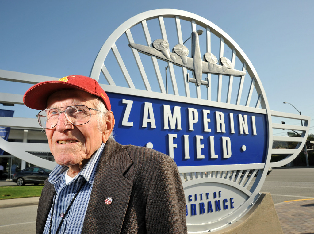 Description of . Louis Zamperini was honored Tuesday with a new sign at the corner of Zamperini Way and Pacific Coast Highway; which leads to Zamperini Field airport. Zamperini was an Olympian and later a bombadier on a B-24 Liberator that was shot down over the Pacific. March 23, 2010. (Photo by Steve McCrank/Daily Breeze)