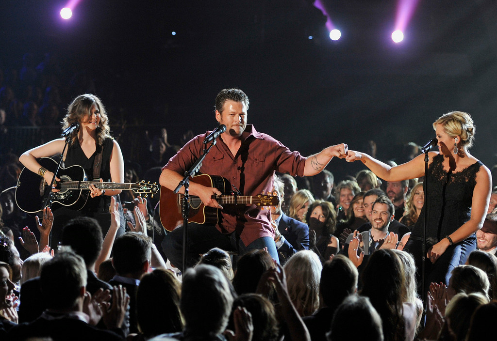 Description of . Blake Shelton, center, performs at the 48th Annual Academy of Country Music Awards at the MGM Grand Garden Arena in Las Vegas on Sunday, April 7, 2013. (Photo by Chris Pizzello/Invision/AP)