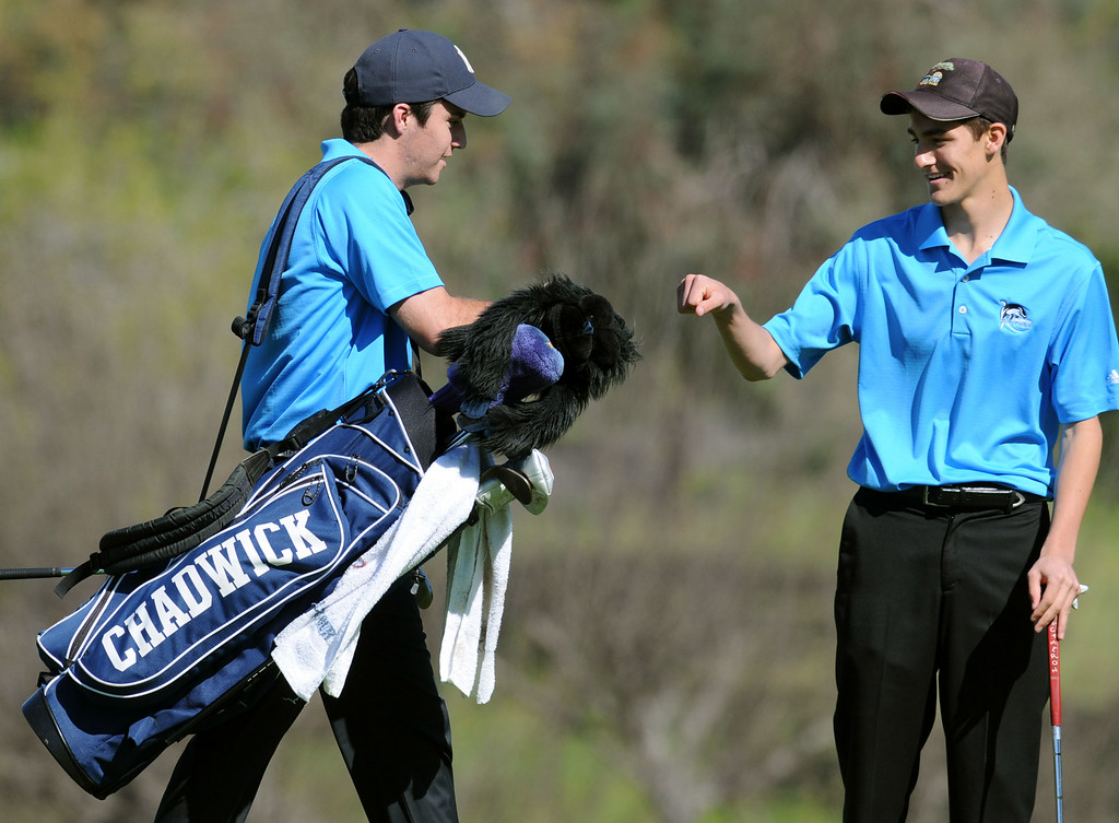 Description of . Chadwick's Greg Stone, left, and Ethan Leff, right, fist bump on the second hole against Peninsula in a round of golf Tuesday at the Palos Verdes Golf Club.