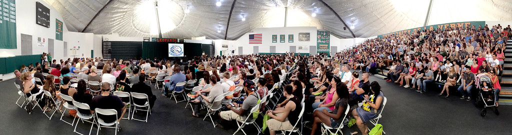 Description of . University of La Verne incoming freshman and their parents gather in the gym for a welcoming presentation, on move-in day, Wednesday August 20, 2014,  in preparation for the upcoming fall semester at the University of La Verne.  (Nancy Newman/for the Inland Valley Daily Bulletin)