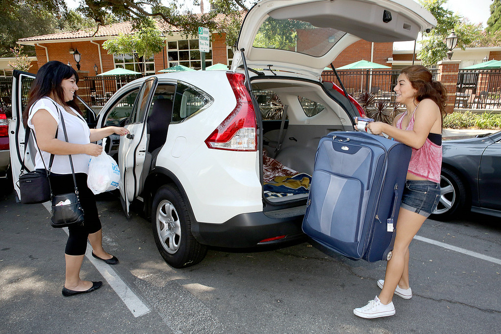 Description of . University of La Verne incoming freshman Amanda Hernandez of San Diego, gets some help from her mom Carmen Hernandez on move-in day, Wednesday August 20, 2014, as students move into the dorms, in preparation for the new fall semester at the University of La Verne, in August 2014.  (Nancy Newman/for the Inland Valley Daily Bulletin)