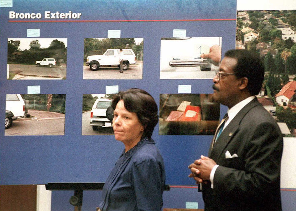 Description of . Rosa Lopez(L), a key defense witness in the O.J. Simpson murder trial, and defense attorney Johnnie Cochran Jr.(R), appear in front of a display of Simpson's Bronco truck in Superior Court in Los Angeles 27 February. Lopez, a housekeeper to a neighbor of O.J. Simpson's, claims to have seen a white Ford Bronco outside his home at around the time the prosecution claims the murders of Nicole Brown Simpson and Ron Goldman took place.  (POO/AFP/Getty Images)