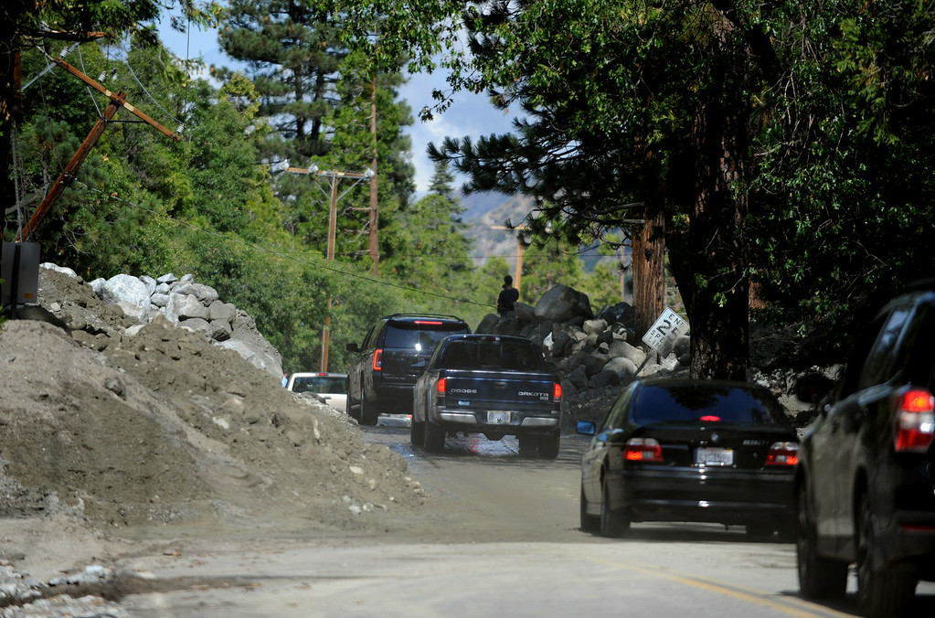 Description of . Valley of the Falls Road is re-opened allowing hikers and visitors to return home on Monday, August 4, 2014 in Forest Falls, Ca. Sunday's flash flood caused closure of the road and damage to multiple homes. (Micah Escamilla/San Bernardino Sun)