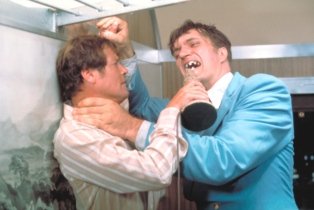Description of . This undated publicity photo provided by United Artists and Danjaq, LLC shows Richard Kiel, right, as Jaws and Roger Moore, as James Bond, fighting in the 1977 film,