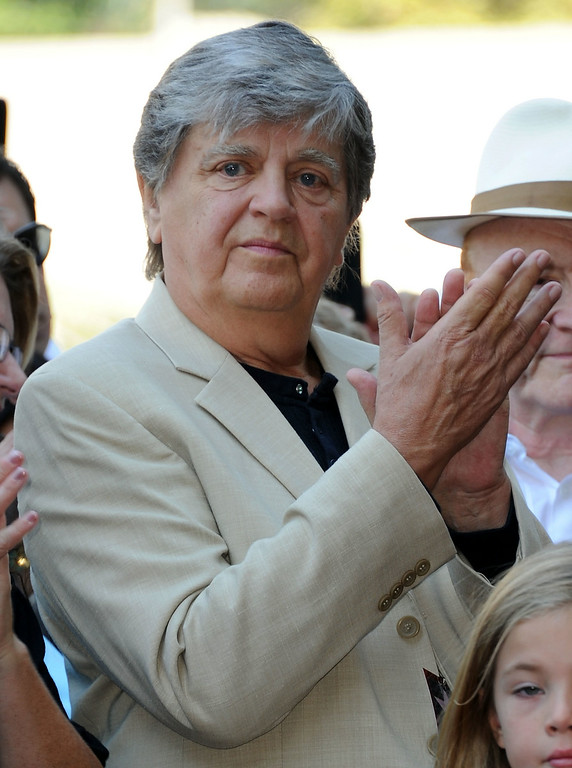 Description of . Guitarist Phil Everly attends the Buddy Holly Hollywood Walk Of Fame Induction Ceremony in Hollywood, California September 7, 2011.  Everly died Friday, Jan. 3, 2014. He was 74. http://bit.ly/1q5AlE8   (VALERIE MACON/AFP/Getty Images)