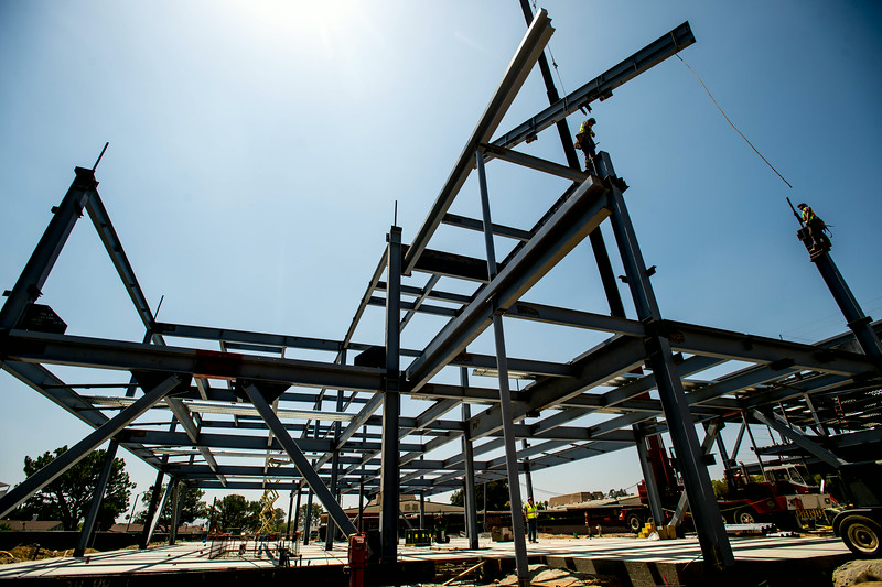 Workers install steel beams on the new administrative and classroom building at Nogales High School in La Puente on Tuesday, June 25, 2014. The multi-million dollar project that will change the face of the Rowland Unified School. (Photo by Watchara Phomicinda/ San Gabriel Valley Tribune)