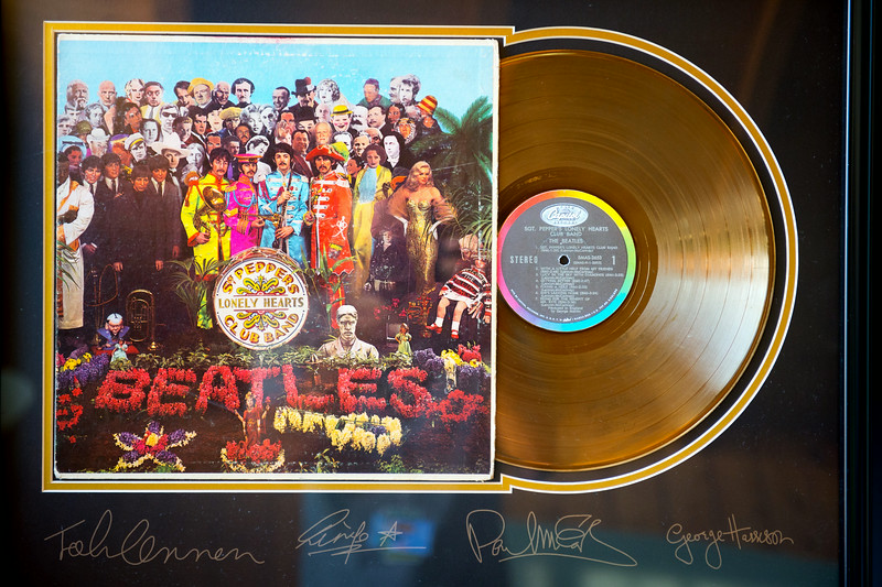 """Description of . A framed and autographed Sgt. Peppers Lonely Hearts Club Band album in Ivor Davis' Ventura home. Davis has written a book, """"The Beatles and Me on Tour,"""" about his adventures with the lads while he was covering their 1964 summer tour of America. Tuesday, August 26, 2014. (Photo by Michael Owen Baker/Los Angeles Daily News)"""