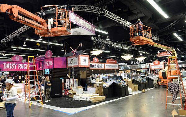 Workers set up the Daisy Rock booth for the NAMM Show at the Anaheim Convention Center on Wednesday January 22, 2014. The NAMM Show, National Association of Music Merchants, is a trade-only event for the music products industry that is held every January. It is one of the two largest music product trade shows in the world. (Staff Photo by Keith Durflinger/San Gabriel Valley Tribune)
