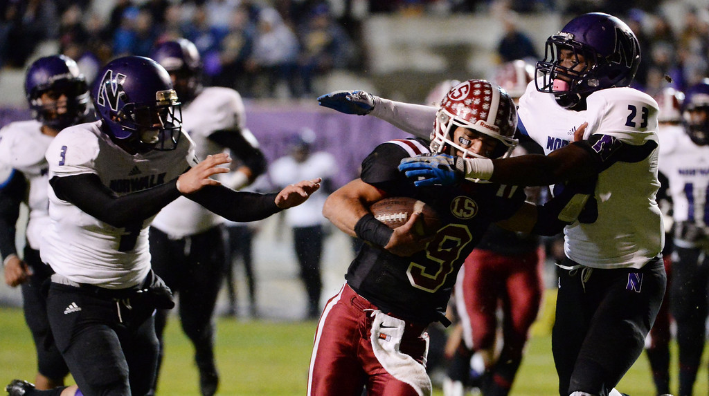 Description of . La Serna quarterback Frankie Palmer (9) runs for a touchdown as Norwalk's Dante Foster (23) tries to make the tackle in the first half of a CIF-SS Southeast Division championship football game at Cal State Fullerton stadium in Fullerton, Calif., on Saturday, Dec. 7, 2013.   (Keith Birmingham Pasadena Star-News)