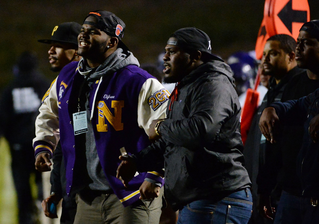 Description of . Norwalk fans react after a touchdown against La Serna in the first half of a CIF-SS Southeast Division championship football game at Cal State Fullerton stadium in Fullerton, Calif., on Saturday, Dec. 7, 2013.   (Keith Birmingham Pasadena Star-News)