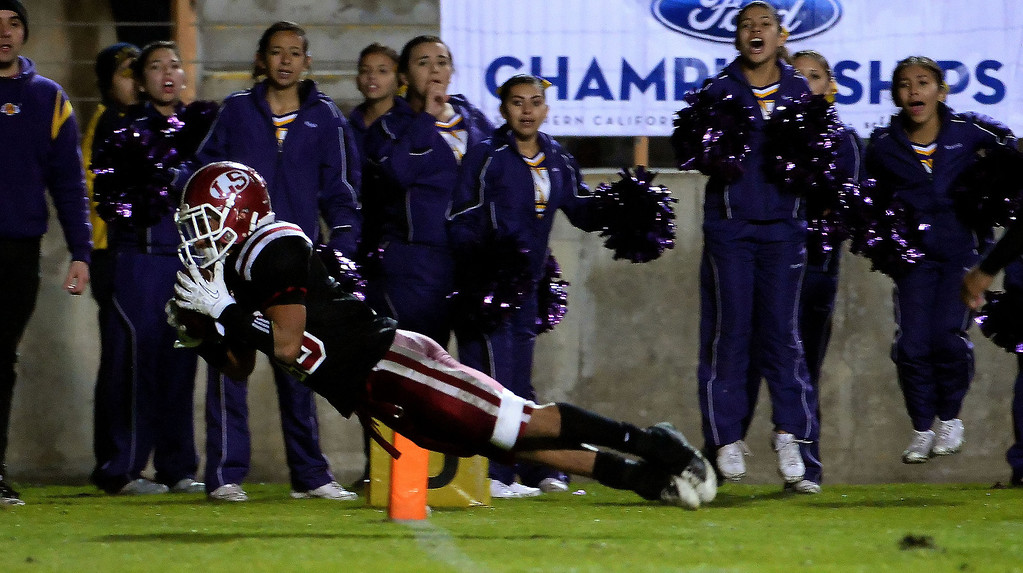 Description of . La Serna's Matthew Rosales catches a 19 yard pass on 4th and 4 from quarterback Frankie Palmer (not pictured) in double over-time to defeat Norwalk 41-38 during a CIF-SS Southeast Division championship football game at Cal State Fullerton stadium in Fullerton, Calif., on Saturday, Dec. 7, 2013.   (Keith Birmingham Pasadena Star-News)