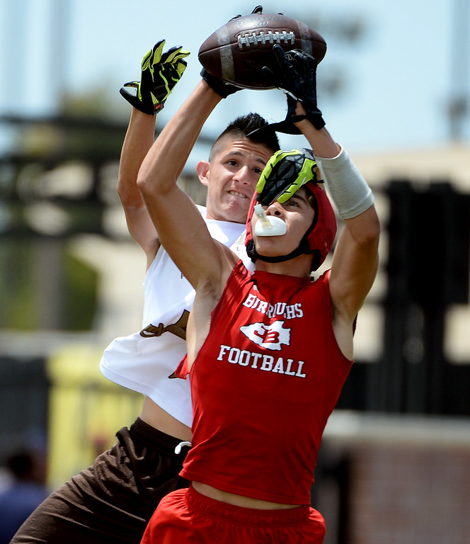Description of . Don Lugo vs. Burroughs during a passing league game during the Tournament of Champions at Santa Fe High School in Santa Fe Springs, Calif., on Saturday, July 12, 2014.   (Keith Birmingham/Pasadena Star-News)