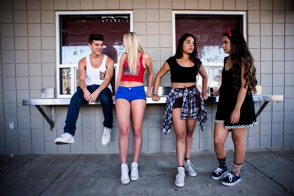 Description of . Travis Nunez, 19, Kaitlin Haugen, 17, Mouriann Cendejas, 17, and Madi Hurst, 17, hang out in at La Mirada Regional Park's snack bar before La Mirada's annual fireworks show and festival Thursday night, July 3, 2014. (Photo by Sarah Reingewirtz/Pasadena Star-News)