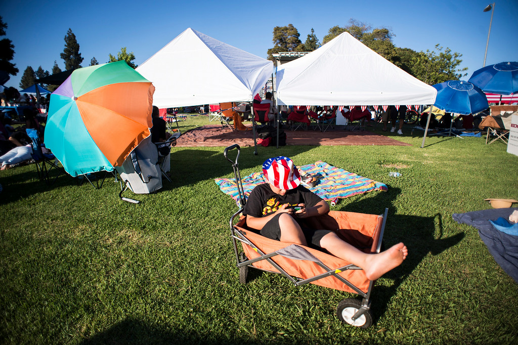 Description of . Aidan O'neill, 11, hangs out in a wagon  before La Mirada's annual fireworks show and festival Thursday night, July 3, 2014 at La Mirada Regional Park. (Photo by Sarah Reingewirtz/Pasadena Star-News)