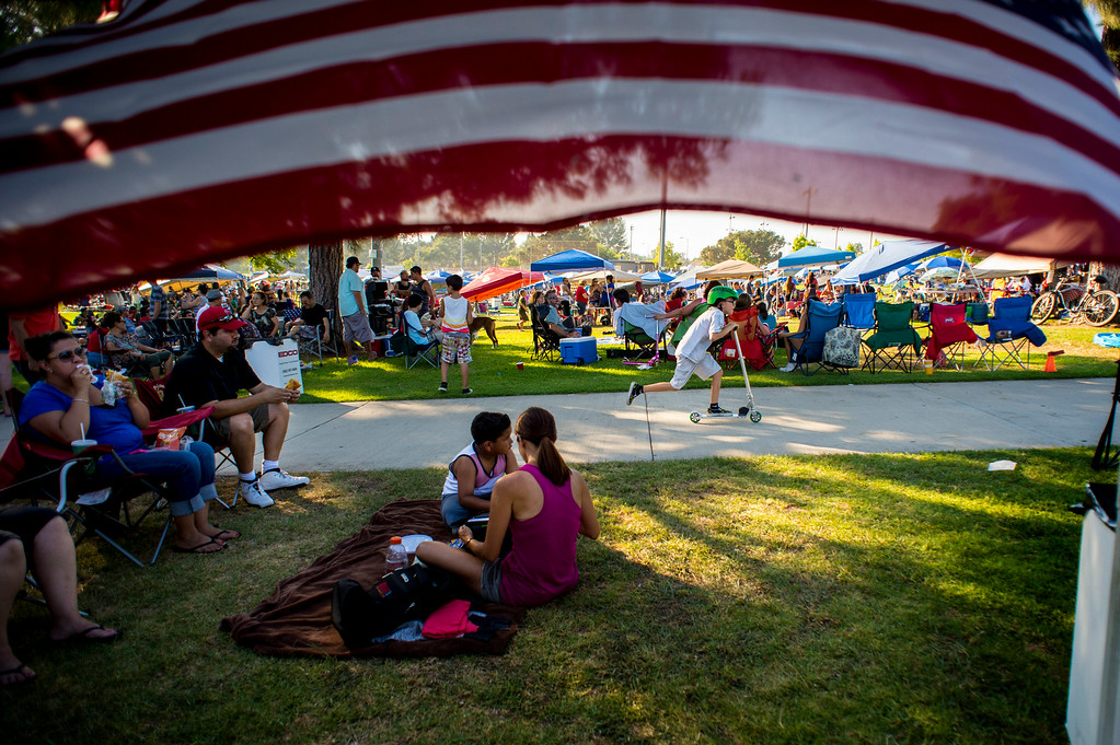 Description of . The Valdivia Family's flag flies as 50 members of their family gathers for La Mirada's annual fireworks show and festival Thursday night, July 3, 2014 at La Mirada Regional Park. (Photo by Sarah Reingewirtz/Pasadena Star-News)