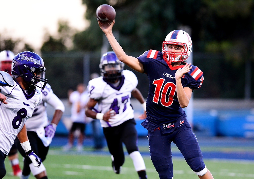 Description of . La Salle's quarterback Aaron McCorkle goes for a pass during the first half of Friday night's game against  Cathedral at La Salle High School in Pasadena, on August 30, 2013. (Photo by Sarah Reingewirtz/Pasadena Star-News)