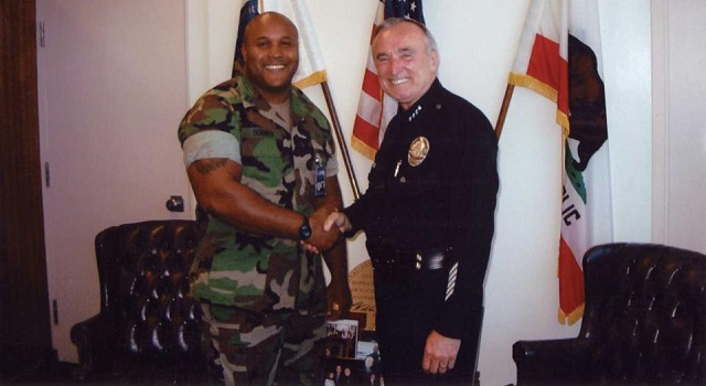 Former LAPD chief William Bratton congratulates Christopher Dorner
