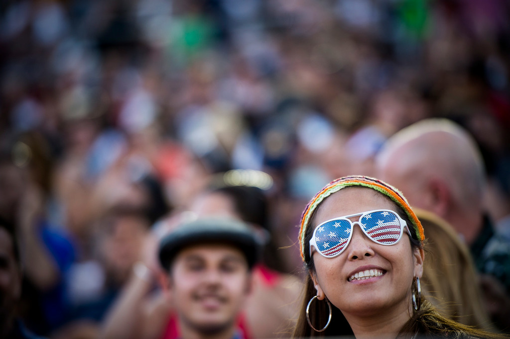 Description of . Lorraine Cabatingan-Beddawi watches the 88th Annual Fourth of July Celebration, Americafest at the Rose Bowl in Pasadena Friday night, July 4, 2014. (Photo by Sarah Reingewirtz/Pasadena Star-News)