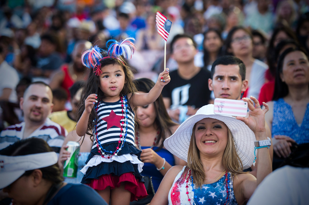 Description of . Sandy Oak, of Rancho Cucamonga, and her 4-year-old daughter Jaely attend the 88th Annual Fourth of July Celebration, Americafest as they watch Ian Thomas perform at the Rose Bowl in Pasadena Friday night, July 4, 2014. (Photo by Sarah Reingewirtz/Pasadena Star-News)