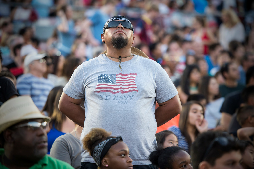 Description of . Veteran AtaIgnacio Viera, a Temple city resident who served a tour in Iraq, stands as veterans are honored during the 88th Annual Fourth of July Celebration, Americafest at the Rose Bowl in Pasadena Friday night, July 4, 2014. (Photo by Sarah Reingewirtz/Pasadena Star-News)