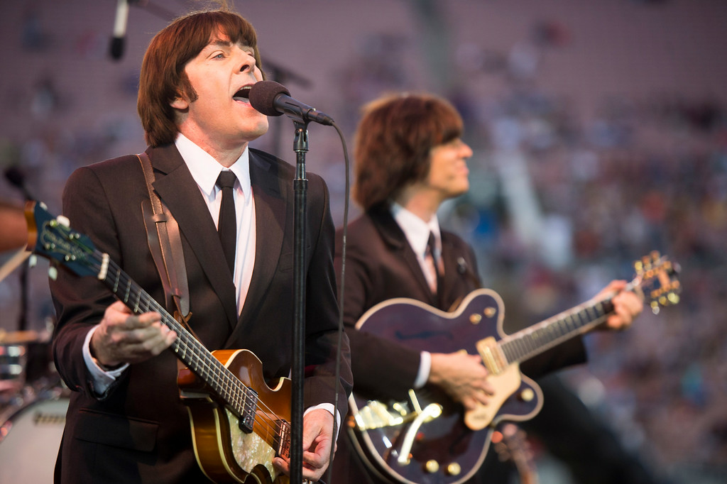 Description of . Liverpool Legends, a Beatles tribute band, performs during the 88th Annual Fourth of July Celebration, Americafest at the Rose Bowl in Pasadena Friday night, July 4, 2014. (Photo by Sarah Reingewirtz/Pasadena Star-News)