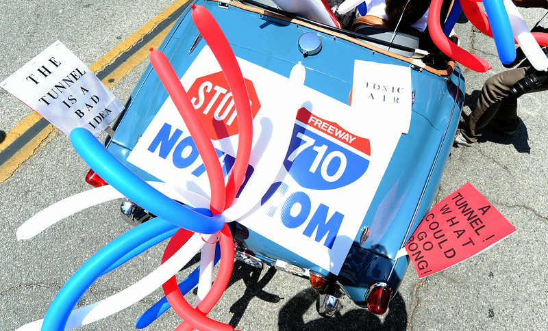 Description of . Citizens march to oppose Matro's $12 billion 710 freeway toll tunnel project during the Festival of Balloons Parade at the South Pasadena Library in South Pasadena, Calif., on Friday, July 4, 2014.  (Keith Birmingham Pasadena Star-News)