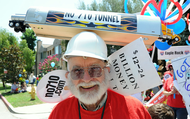 Description of . Tom Williams march to oppose Matro's $12 billion 710 freeway toll tunnel project during the Festival of Balloons Parade at the South Pasadena Library in South Pasadena, Calif., on Friday, July 4, 2014.  (Keith Birmingham Pasadena Star-News)