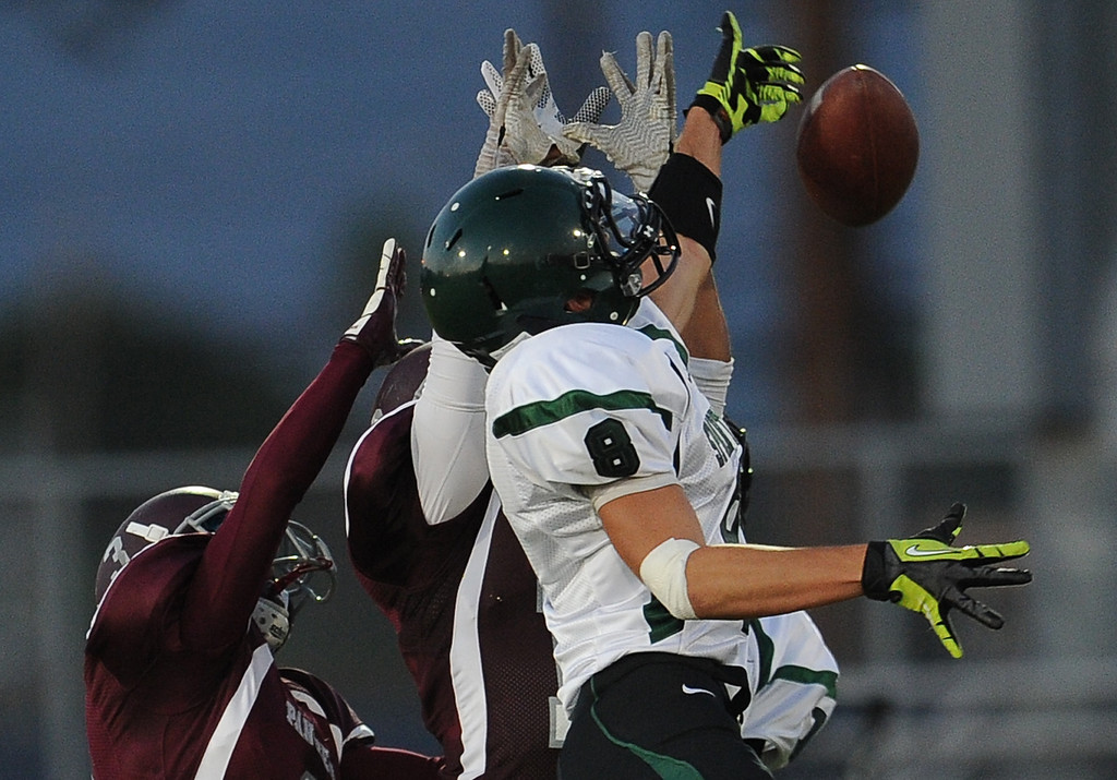 Description of . South Torrance's Ben Sampson (8) knocks away a pass in tended for Rosemead in the first half of a prep football game at Rosemead High School in Rosemead, Calif. on Thursday, Sept. 12, 2013.   (Photo by Keith Birmingham/Pasadena Star-News)