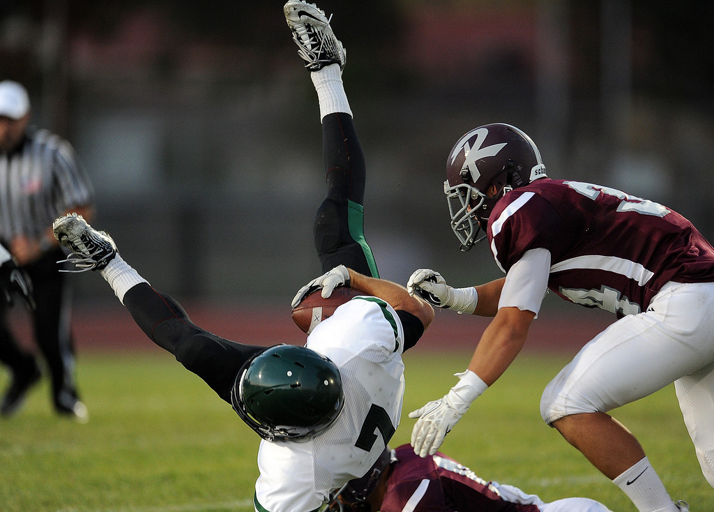 Description of . South Torrance's Vinni Bjazevich (7) runs for yardage against Rosemead in the first half of a prep football game at Rosemead High School in Rosemead, Calif. on Thursday, Sept. 12, 2013.   (Photo by Keith Birmingham/Pasadena Star-News)