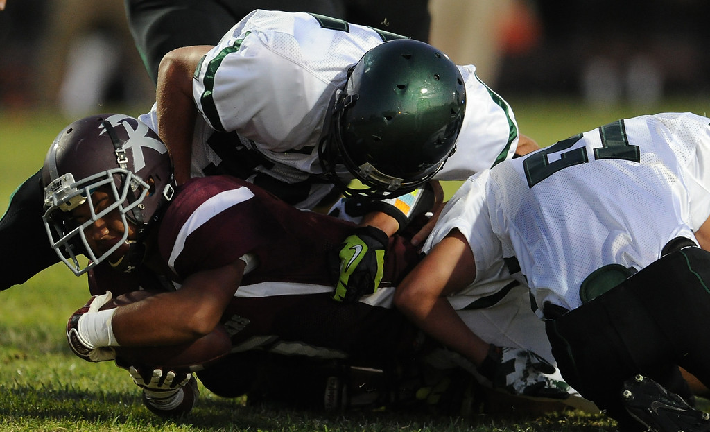 Description of . Rosemead's Angel Lopez (5) dives for the first down against South Torrance in the first half of a prep football game at Rosemead High School in Rosemead, Calif. on Thursday, Sept. 12, 2013.   (Photo by Keith Birmingham/Pasadena Star-News)