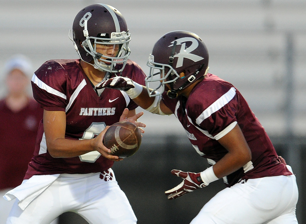Description of . Rosemead quarterback Isaia Ah-hing (8) hands-off to Angel Lopez in the first half of a prep football game at Rosemead High School in Rosemead, Calif. on Thursday, Sept. 12, 2013.   (Photo by Keith Birmingham/Pasadena Star-News)