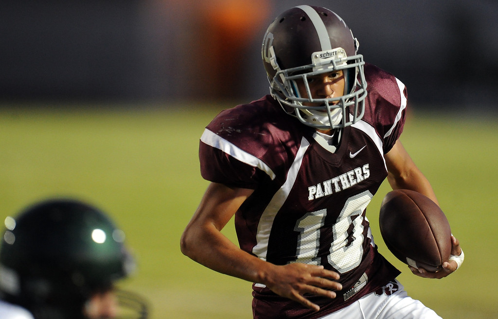 Description of . Rosemead's Patrick Lopez (10) runs for a touchdown against South Torrance in the first half of a prep football game at Rosemead High School in Rosemead, Calif. on Thursday, Sept. 12, 2013.   (Photo by Keith Birmingham/Pasadena Star-News)