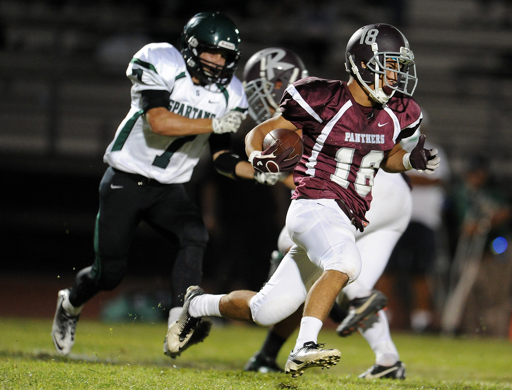 Description of . Rosemead's Stephen Cansino (16) runs for a first down against South Torrance in the first half of a prep football game at Rosemead High School in Rosemead, Calif. on Thursday, Sept. 12, 2013.   (Photo by Keith Birmingham/Pasadena Star-News)