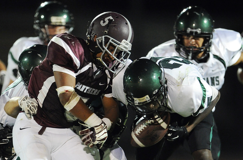 Description of . Rosemead's Angel Lopez (5) funnels as South Torrance (25) recovers and score a touchdown in the first half of a prep football game at Rosemead High School in Rosemead, Calif. on Thursday, Sept. 12, 2013.   (Photo by Keith Birmingham/Pasadena Star-News)