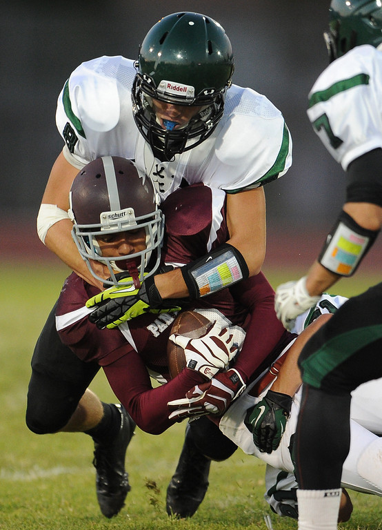 Description of . Rosemead's Luis Luna (3) is  tackles by South Torrance's Ben Sampson (8) in the first half of a prep football game at Rosemead High School in Rosemead, Calif. on Thursday, Sept. 12, 2013.   (Photo by Keith Birmingham/Pasadena Star-News)