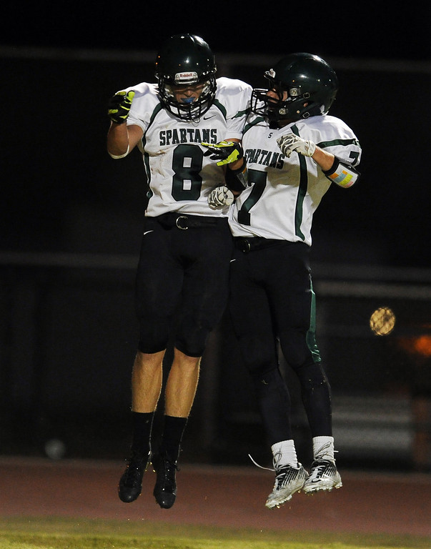 Description of . South Torrance's Ben Sampson (8) reacts with teammate Vinni Bjazevich (7) after scoring a touchdown against Rosemead in the first half of a prep football game at Rosemead High School in Rosemead, Calif. on Thursday, Sept. 12, 2013.   (Photo by Keith Birmingham/Pasadena Star-News)