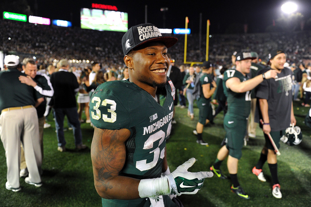 Description of . Michigan State RB Jeremy Langford celebrates after beating Stanford 24-20 at the Rose Bowl, Wednesday, January 1, 2014. (Photo by Michael Owen Baker/L.A. Daily News)