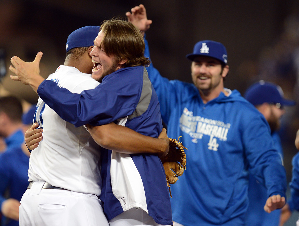 Description of . The Dodgers' Kenley Jansen hugs Clayton Kershaw after the final out against  the Atlanta Braves during game 4 of the NLDS at Dodger Stadium Monday, October 7, 2013. The Dodgers beat the Braves 4-3.(Photo by Hans Gutknecht/Los Angeles Daily News)