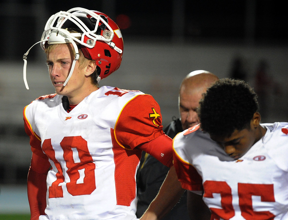 Description of . Paraclete's Brett Nelson (18) reacts after losing to San Dimas 20-14 a CIF-SS Mid-Valley Division championship football game at San Dimas High School in San Dimas, Calif., on Friday, Dec. 6, 2013.   (Keith Birmingham Pasadena Star-News)