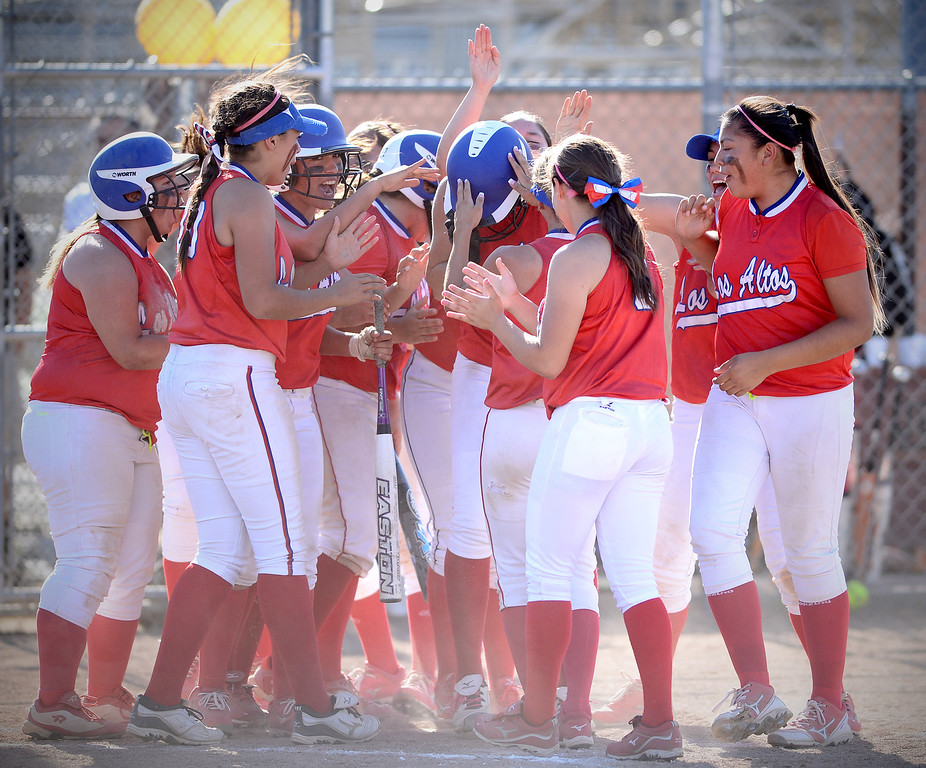 Description of . Los Altos celebrates tying up in the 6th after pitcher Celeste Wood's home run Thursday, May 15, 2014 at West Covina High School. Los Altos beat West Covina 4-3. (Photo by Sarah Reingewirtz/Pasadena Star-News)