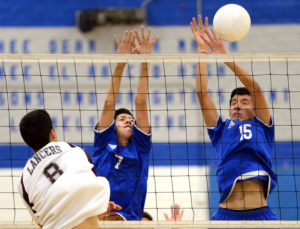 Description of . El Rancho's Anthony Arauz-Diaz (#7) and Bryan Rojas (#15) block a shot from Bell Gardens' Charlie Hernandez (#8) in their non-league game at El Rancho High School in Pico Rivera on Friday March 28, 2014. Bell Gardens defeated El Rancho 3-2 games. (Staff Photo by Keith Durflinger/Whittier Daily News)