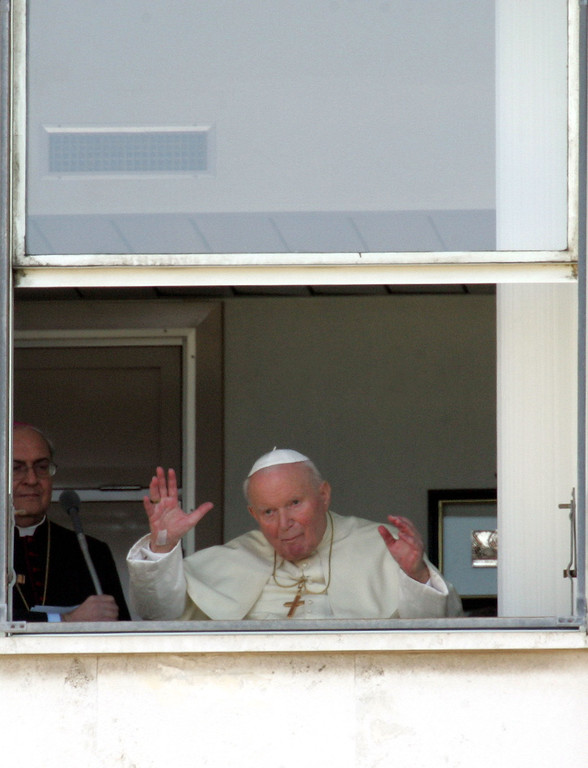 Description of . Pope John Paul II waves to faithful from a window of Rome's Agostino Gemelli hospital where he appeared  Sunday, Feb. 6, 2005. Pope John Paul II was rushed to the hospital Thursday, Feb. 24, 2005, after suffering a relapse of the flu, the Vatican announced, a day after the pontiff made his longest public appearance since being discharged from the clinic two weeks ago. The 84-year-old pontiff was taken to Gemelli Polyclinic hospital after the return of flu symptoms Wednesday afternoon. He was hospitalized for