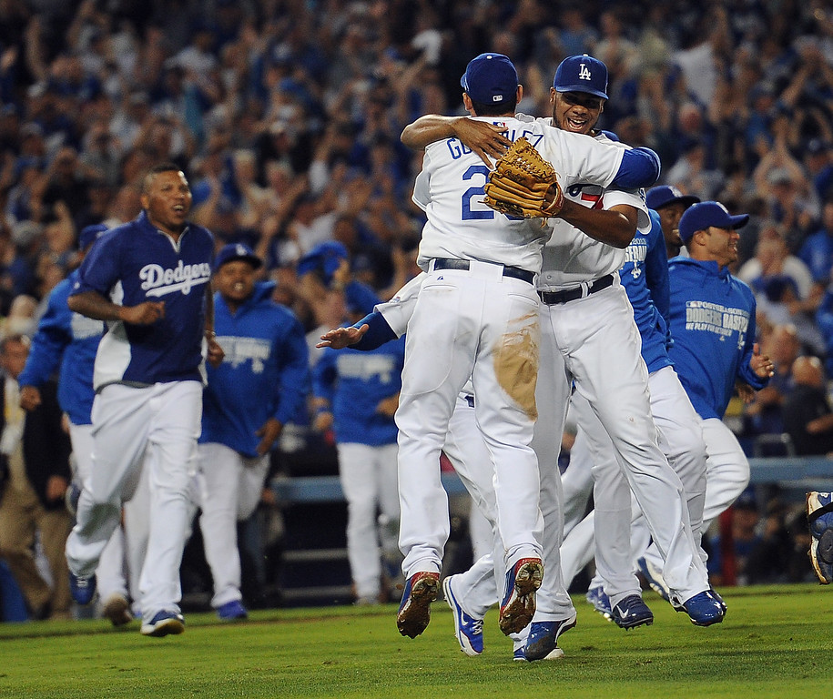 Description of . The Los Angeles Dodgers run on to the field after beating the Atlanta Braves during game 4 of the NLDS at Dodger Stadium Monday, October 7, 2013. The Dodgers beat the Braves 4-3.(Photo by Hans Gutkencht/Los Angeles Daily News)