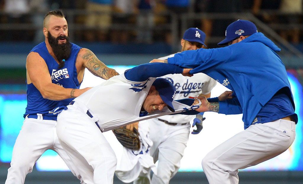 Description of . Dodger players celebrate follwing their victory over the Braves October 7, 2013.(Andy Holzman/Los Angeles Daily News )