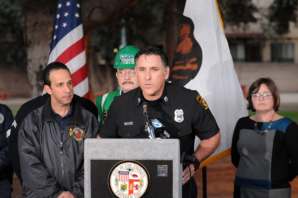 Description of . LAFD Captain Moore talks to the audience.   Councilman Mitch Englander, other officials and residents recalled the 1994 Northridge earthquake, 20 years later, by lighting luminaries and sharing