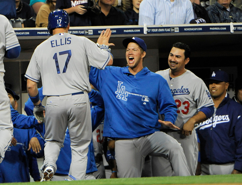 Description of . A.J. Ellis #17 of the Los Angeles Dodgers is congratulated by teammates after hitting a two-run homer in the second inning of a baseball game against the San Diego Padres at Petco Park on April 10, 2013 in San Diego, California. Dodgers won 4-3  (Photo by Denis Poroy/Getty Images)